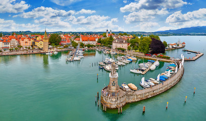 Foto op Plexiglas Kust Lindau, Germany. Antique bavarian town at Lake Constance (Bodensee). Monument with statue of lion at entrance to port, yachts by piers. Summer landscape blue sky.