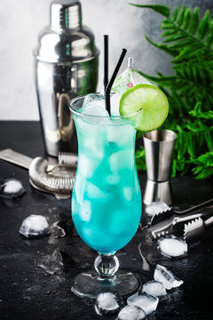 Blue Hawaiian or Blue Lagoon cocktail - summer alcoholic drink with vodka, liqueur, tonic, pineapple juice and ice. Copy space, selective focus
