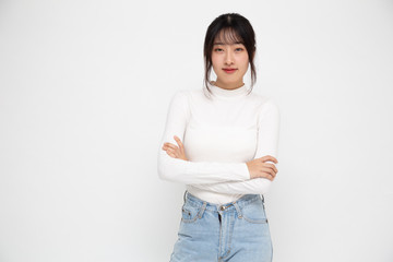 Portrait of asian women with arms crossed and smile isolated over white background, Young woman smiling and looking at camera, Happy feeling concept