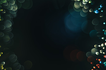 Beautiful multi colored bokeh background on a dark. Wall mural