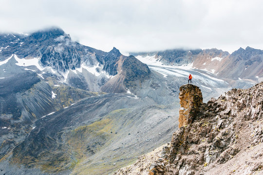 A woman takes in the view on a hike in Lake Clark National Park and Preserve, Alaska, USA