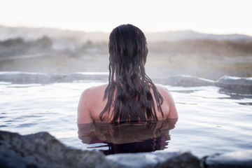 Rear view of woman in hot spring