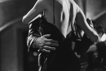 A man and a woman dancing tango. Black and white image
