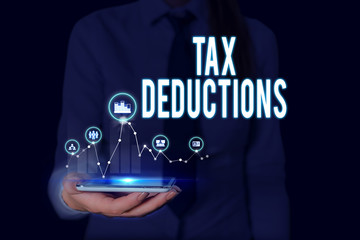 Text sign showing Tax Deductions. Business photo text an amount or cost that subtracted from someone s is income Woman wear formal work suit presenting presentation using smart device