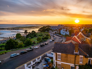 Foto op Aluminium Zee zonsondergang Aerial view of the skyline in Southend on sea village in sunset light.