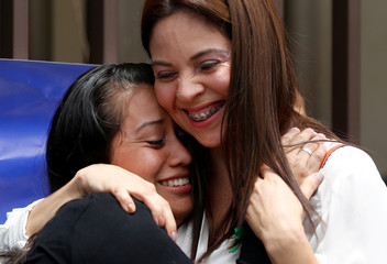 Evelyn Hernandez, who was sentenced to 30 years in prison for a suspected abortion, embraces her lawyer Bertha Deleon after being absolved at a hearing in Ciudad Delgado