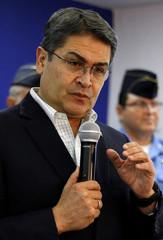 Honduras' President Juan Orlando Hernandez speaks during a news conference at the Presidential House in Tegucigalpa