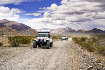 May 27, 2018 Death Valley / CA / USA - Jeep vehicles travelling on an unpaved road through a remote part of Death Valley National Park