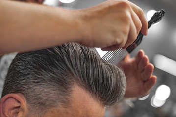 Fotobehang Kapsalon Barber does hair styling. Men's Hair Care.