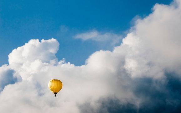 Hot air balloon at Oberhofen against cloudy sky