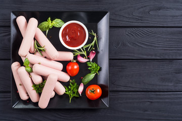 Raw beef sausages with pepper , herbs and ketchup