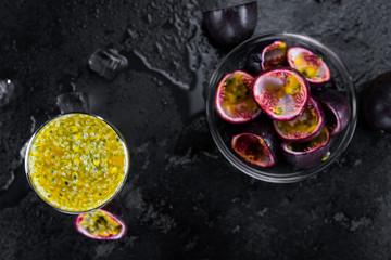 Slate slab with Maracuja Juice (selective focus; close-up shot)