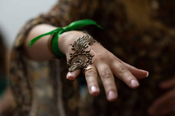Close up of painted hand woman with henna in a party in Morocco.