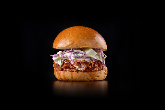 Pulled pork sandwich on rustic decorated scene
