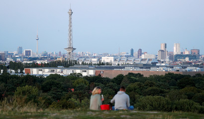 The city's skyline is pictured with the TV tower and radio tower during the early evening in Berlin