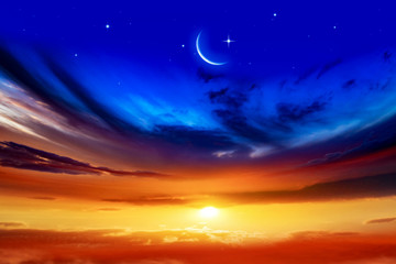 Beautiful dark fluffy cloudy sky with sun rays . Crescent moon with beautiful sunset background . Generous Ramadan . New moon. Prayer time.