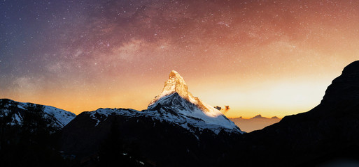 Foto op Plexiglas Zonsondergang Swiss Alps, Panoramic Matterhorn mountain in sunrise with starry sky in dawn