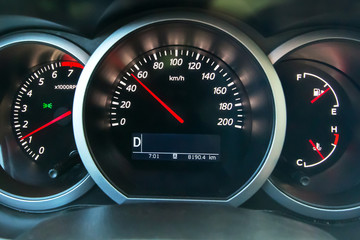 The dashboard of the car, on the speedometer 50 km\h. Observe the speed limit.