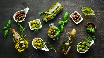Fotomurales - Olives, olive oil, spices and herbs on the Rustic background. Top view. Free space for your text.
