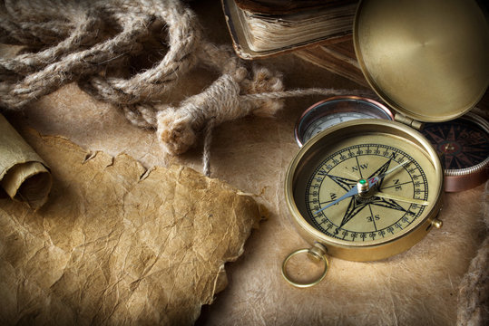 compass and rope on old map