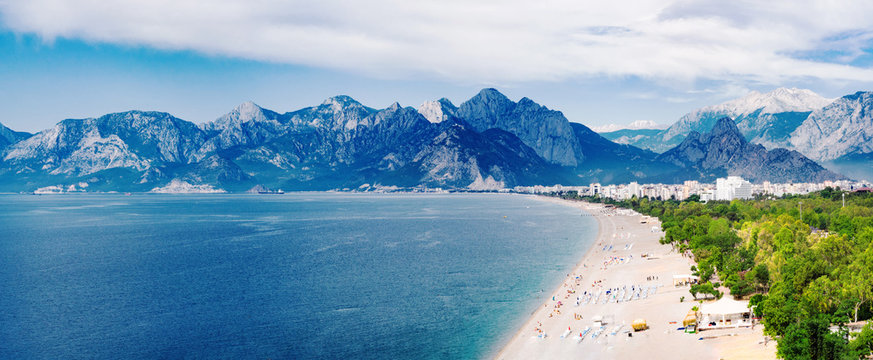 Panoramic view of Konyaalti beach and Mediterranean sea at mountains background in Antalya, Turkey