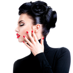 Fototapete - Beautiful young woman with hand near face