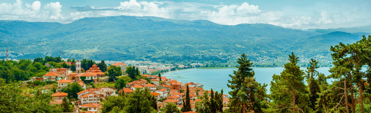 North macedonia. Ohrid. Different buildings and houses with red roofs on lake shore on mountains background
