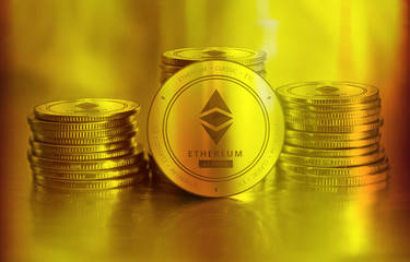 Ethereum Classic (ETC) digital crypto currency. Stack of golden coins. Cyber money.