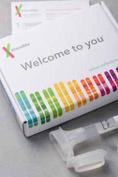 23andMe genome saliva collection kit with tube box and instructions. Illustrative editorial.