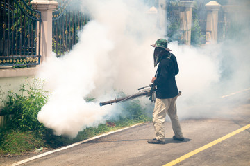 man use fumigation mosquitoes machine for kill mosquito carrier of Zika  and dengue fever around the house