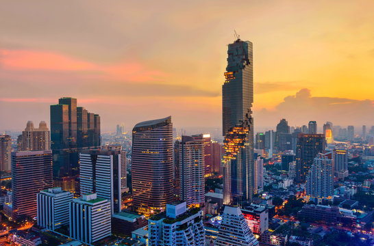 Aerial view of Bangkok modern office buildings, condominium in Bangkok city downtown with sunset sky