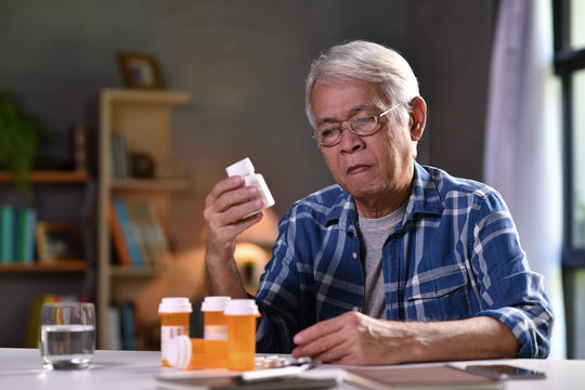 Asian senior man  with his medicine bottles