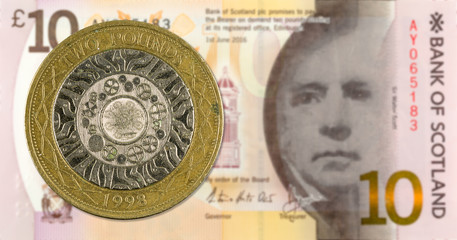 2 Pounds coin against 10 Pounds Sterling note issued by Bank of Scotland reverse