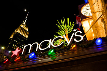 New York, New York, USA - November 24, 2015: Macy's sign and Christmas lights on the roof overhanging the main Broadway entrance of Macy's Herald Square flagship store.