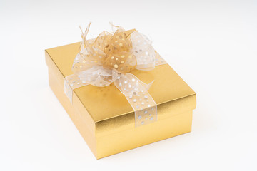 Gold gift box on white background