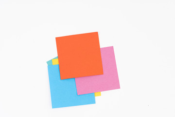 Stack of colorful post-it on white background