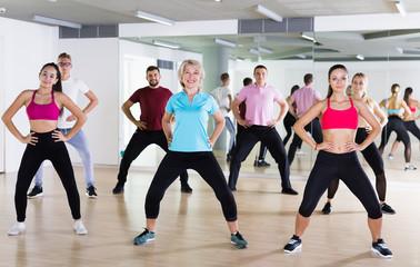 Group of happy people practice sport dance