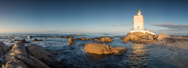 Wide angle panoramic image of the Stompneusbaai lighthouse near Shelley point in town of St Helena Bay on the West coast of South Africa