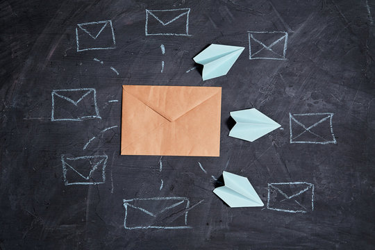 Email marketing and message online, mail communication and e-commerce concept: Paper planes flying to mailbox symbols
