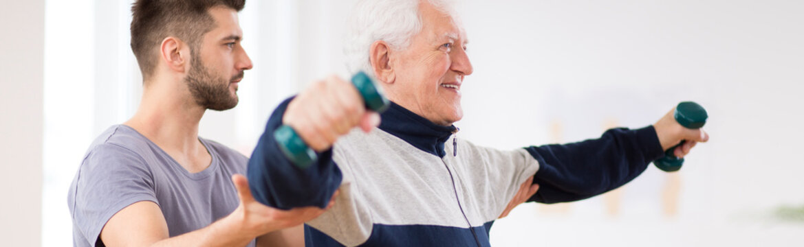 Senior man exercising and recovering at nursing center after heart attack