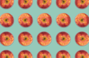 Pattern of red apples, Fruit collage stock photo on sea green background