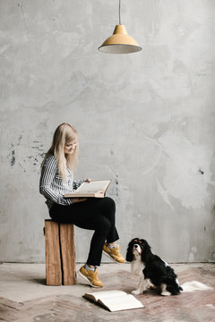 Dog leaning on owner reading book