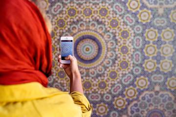 Woman Taking Photo Of Muslim Mosaic