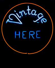 "Neon says """"Vintage HERE"""""