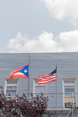 Puerto Rican and American flags flying in Brooklyn