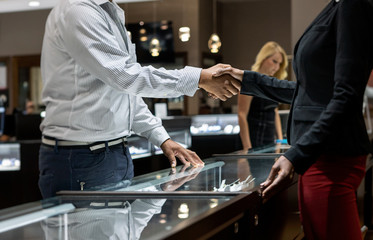 Jewelry: Male Customer Greets Salesperson
