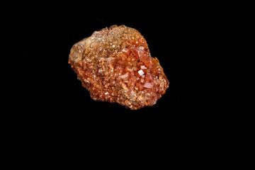 Macro mineral stone Vanadinite on a black background