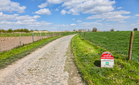 Cysoing,France- April 5, 2014:Image of a specific milestone indicating the start of a cobblestone road included in the route of Paris Roubaix cycling race.