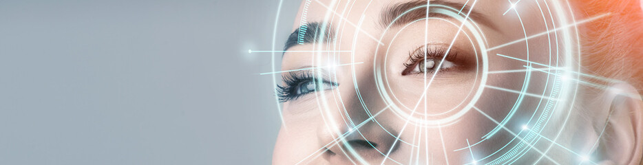 Woman with electronic information analysing inside eye