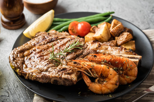 surf and turf, ribeye steak and grilled prawn